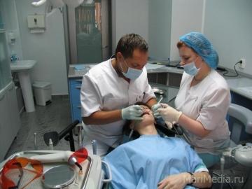 Врач - стоматолог Белов Ю.Е.