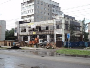 Общественное здание. Конструкция - навесной вентилируемый фасад.  Материал - Knauf Insulation